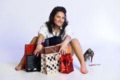 Young woman among shopping bags Stock Photos