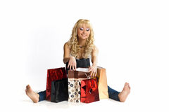 Young woman among shopping bags Royalty Free Stock Photos