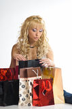 Young woman among shopping bags Stock Photography