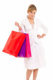 Young woman with shopping bags standing Royalty Free Stock Photos