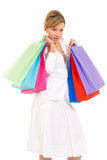 Young woman with shopping bags standing isolated. On white background royalty free stock image