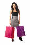 Young woman with shopping bags standing isolated. On white background royalty free stock photo