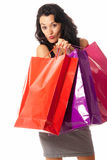 Young woman with shopping bags standing isolated. On white background royalty free stock photography