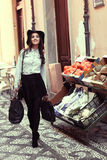Young woman with shopping bags in urban background Stock Photography
