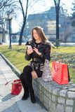 Young woman with shopping bags. Using telephone Stock Photo