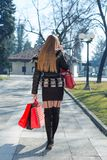 Young woman with shopping bags. Using telephone Stock Photos