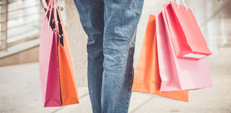 Young woman with shopping bags, walking Royalty Free Stock Photos