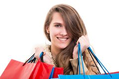 Young woman with shopping bags on white background Royalty Free Stock Images