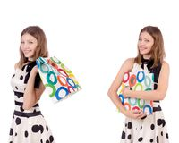 The young woman with shopping bags on white. Young woman with shopping bags on white Stock Photo