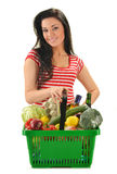Young woman with shopping basket isolated on white Stock Photography