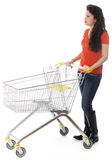 Young woman with shopping cart Royalty Free Stock Photo