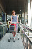 Young woman with shopping cart Royalty Free Stock Images