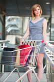 Young woman with shopping cart Stock Image