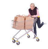 Young woman with shopping cart Stock Photography