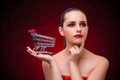 The young woman with shopping cart Royalty Free Stock Images