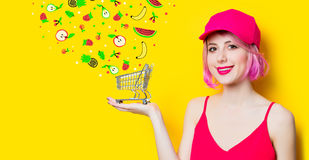 Young woman with shopping cart Royalty Free Stock Photography
