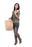 Young woman with shopping and cash Stock Photo