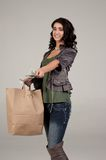 Young woman with shopping and cash Royalty Free Stock Photo