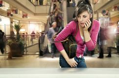 Young woman in shopping center. Looking at something interesting Stock Photo