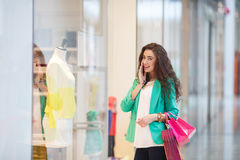 Young woman in a shopping center. Royalty Free Stock Images