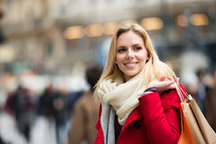 Young woman shopping in centre of the city. Winter Royalty Free Stock Photography
