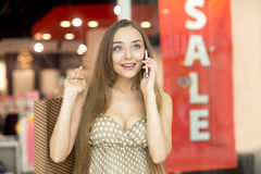 Young woman in shopping centre talking on the phone Stock Photos