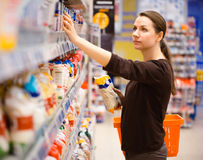 Young woman shopping for cereal, bulk in a grocery supermarket. Beautiful young woman shopping for cereal, bulk in a grocery supermarket Royalty Free Stock Image