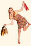 Young woman shopping with color filter effect Royalty Free Stock Images