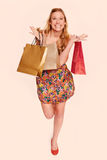 Young woman shopping with color filter effect Stock Photography
