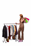 The young woman in shopping concept on white Royalty Free Stock Photography