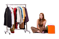 The young woman in shopping concept on white Stock Images