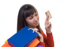 Young woman shopping with credit card holding colourful paper pa Stock Photos