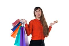 Young woman shopping with credit card holding multicolored paper. Young woman shopping with credit card holding colourful paper bags and packages Royalty Free Stock Photography
