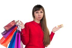 Young woman shopping with credit card holding multicoloured pape. Young woman shopping with credit card holding colourful paper bags and packages Royalty Free Stock Images
