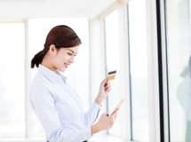 Young woman shopping with credit card and smart phone Royalty Free Stock Images