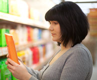 Young woman shopping in a department store. Stock Photos