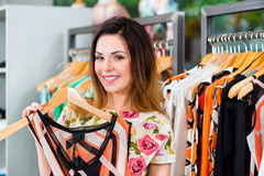 Young woman shopping in fashion department store Royalty Free Stock Photography