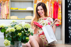 Young woman shopping in fashion department store Stock Photo