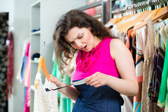 Young woman shopping in fashion department store Stock Image