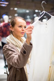 Young woman shopping in a fashion store Royalty Free Stock Photo