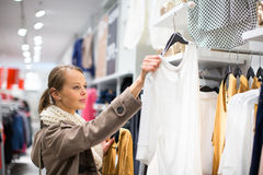 Young woman shopping in a fashion store Royalty Free Stock Image