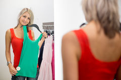 Young woman shopping in a fashion store Stock Image