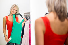 Young woman shopping in a fashion store Royalty Free Stock Images