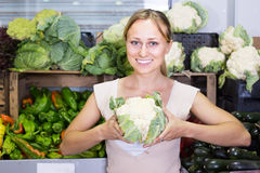Young woman shopping fresh cabbage Royalty Free Stock Photo