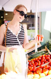 Young woman shopping for fresh tomatoes Royalty Free Stock Photos