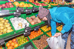 Young woman shopping for fruits in a supermarket Stock Images