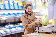Young woman shopping for fruits and vegetables Stock Photography