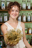 A young woman shopping for herbs Stock Photos