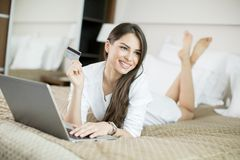 Young woman shopping from home Royalty Free Stock Photography