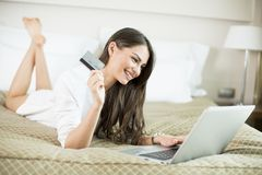 Young woman shopping from home Royalty Free Stock Photos
